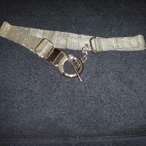 Silver metal mesh adjustable belt.